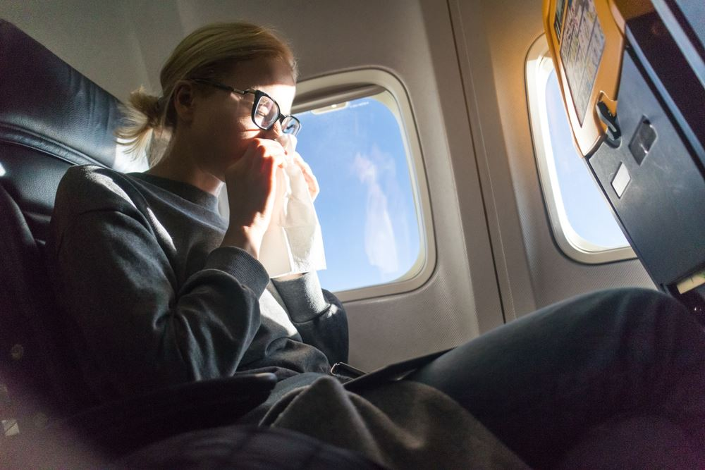 Here's Why It's Dangerous to Fly When Sick or Injured
